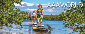 Family paddle boarding in the waterways of southwest Florida