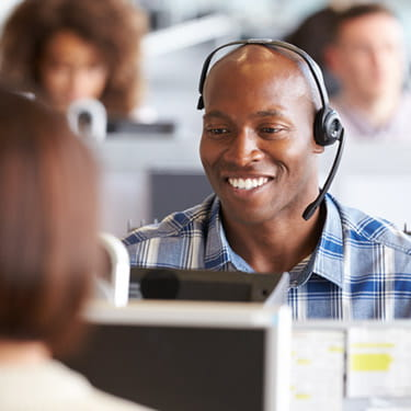 happy man working in a call center