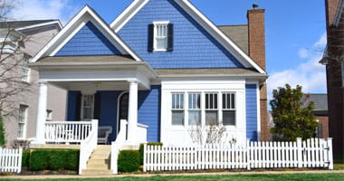 Blue and White Suburban Home with Front Porch