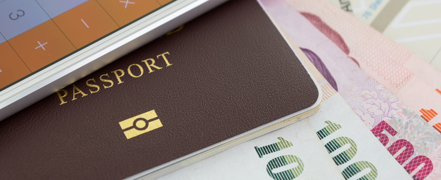 Calculator, Passport and foreign currency