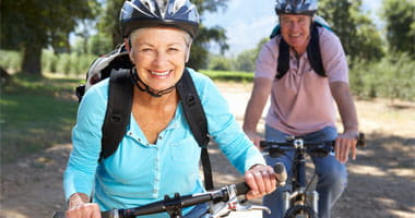 Senior couple bike riding in the park