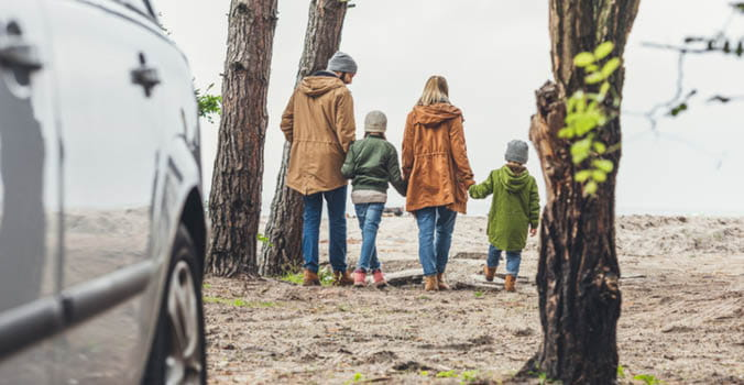 Family walking in wooded area
