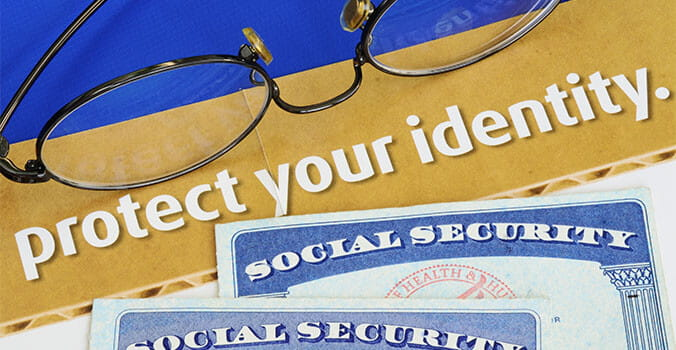 Two Social Security next a pair of Eyeglasses