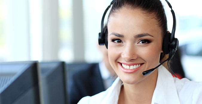 Women with phone headset smiling