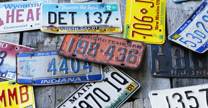 Pile of licenses plates from around the USA