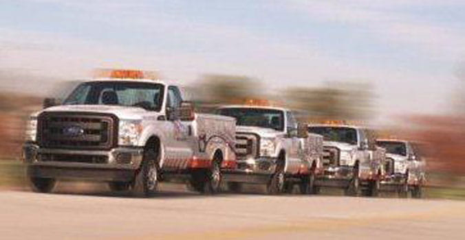 AAA Fleet trucks driving down highway