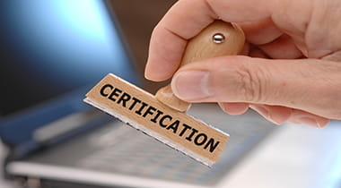 Hand stamping a certification stamp on a piece of paper