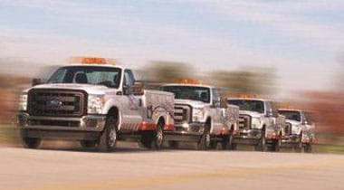 AAA Fleet trucks driving down a highway