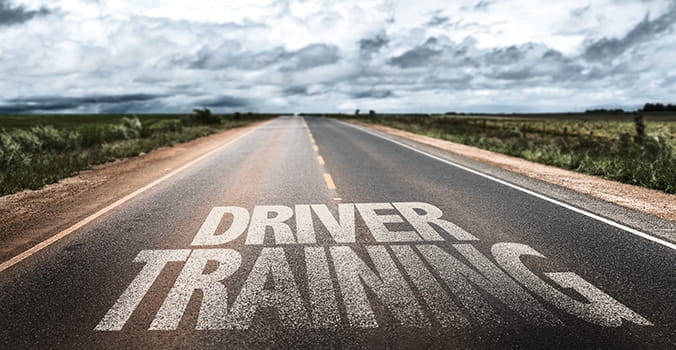 driver training written in white on a highway