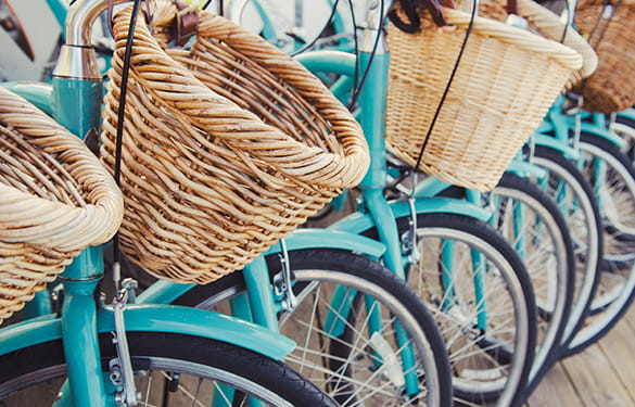line of blue bicycles with baskets