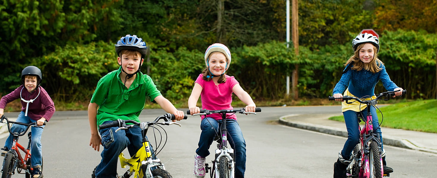 Group of kids in helmets on their bicycles
