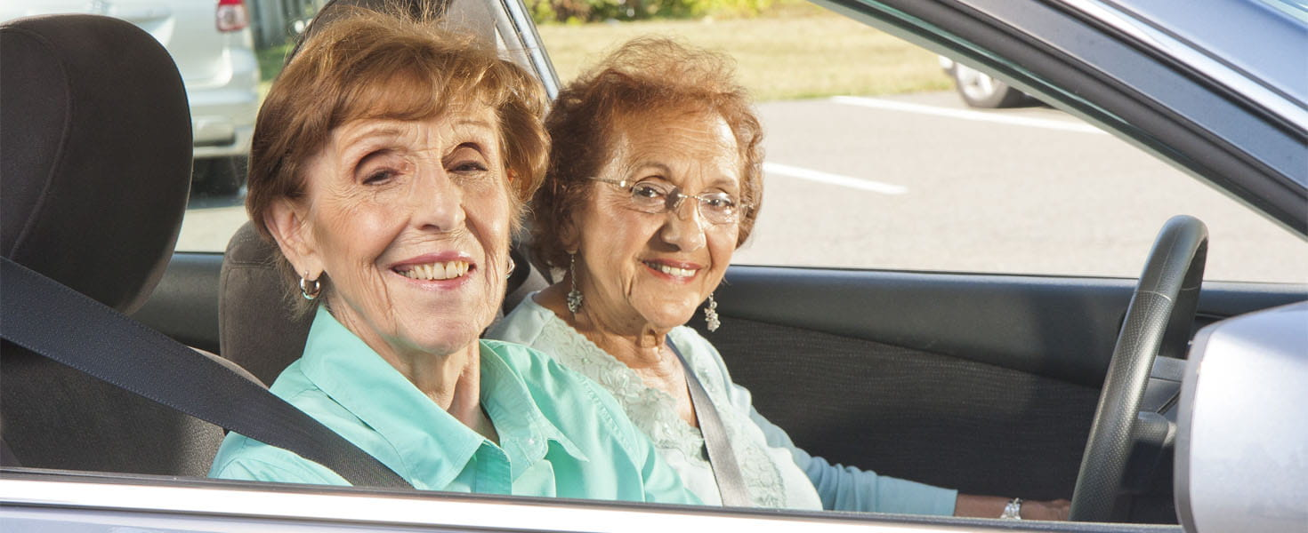 Senior Citizens Friends Drivng in a Car