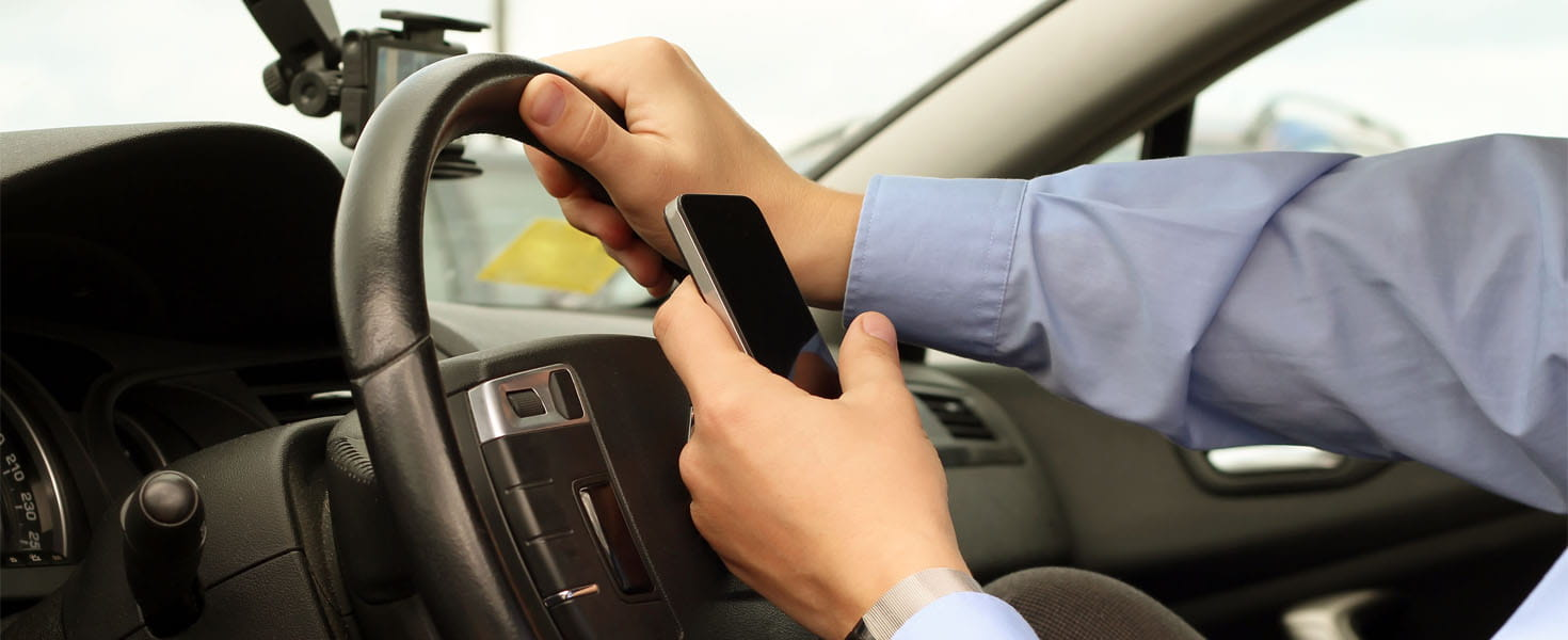 Businessman Using Mobile Smart Phone While Driving