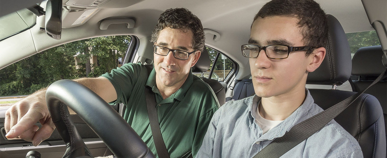 Parent and Teen in a driving vehicle