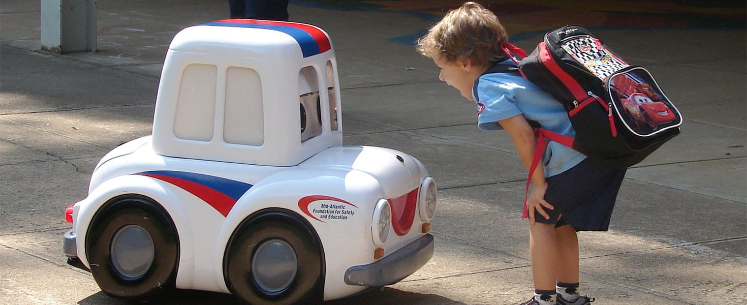 Otto The Auto Toy Car next to a Kid