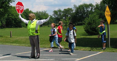 Crossing guards helps kids safety cross the street