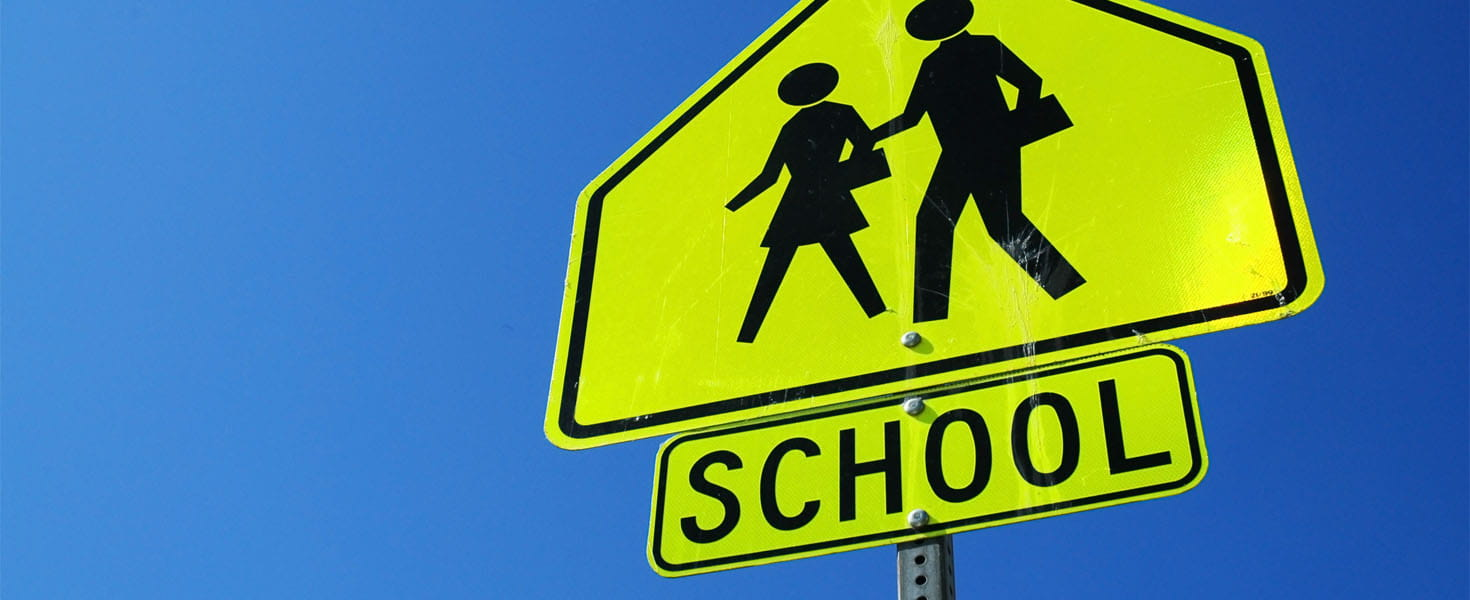 Caution school sign, blue sky