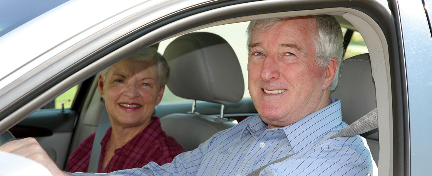 Senior Citizen Couple Driving Their Car