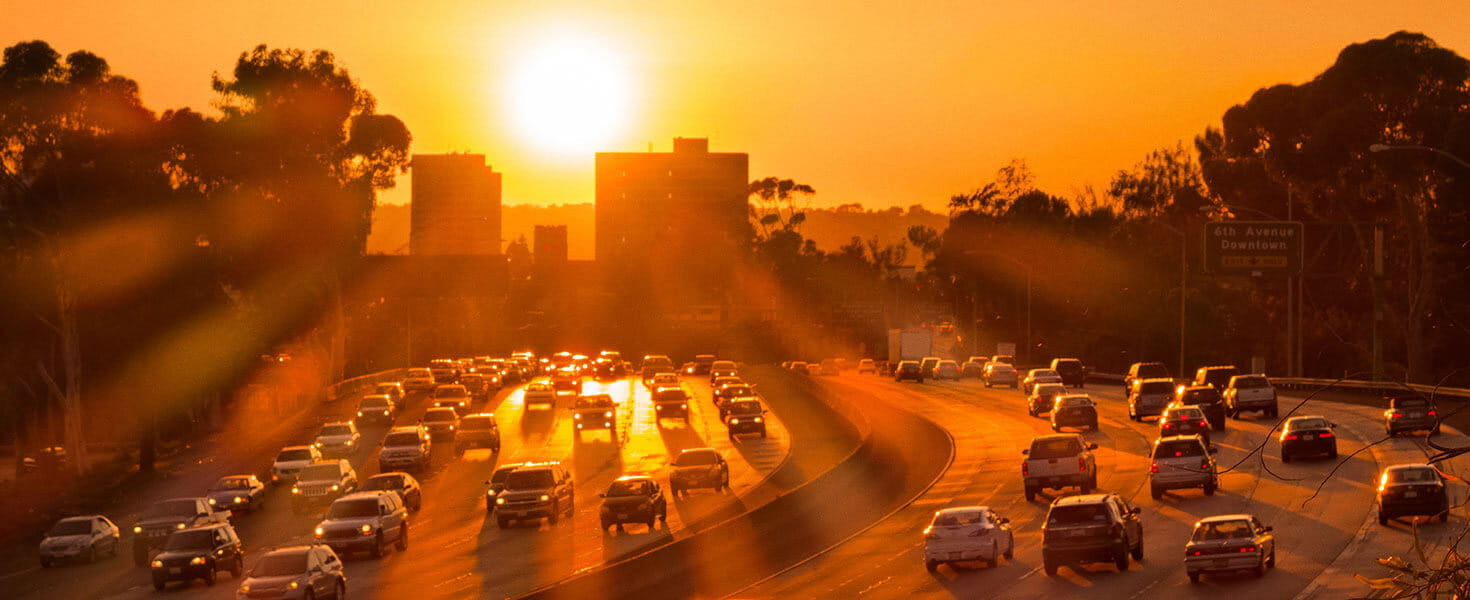 cars-driving-on-highway-in-traffic-at-sun-down