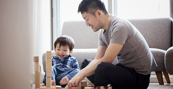 dad playing with blocks with his toddler