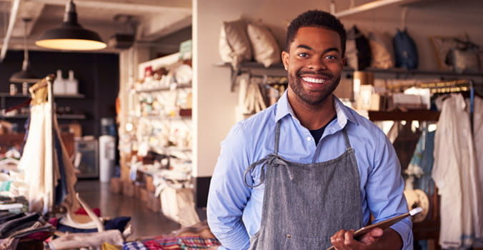 store owner smiling in gift shop
