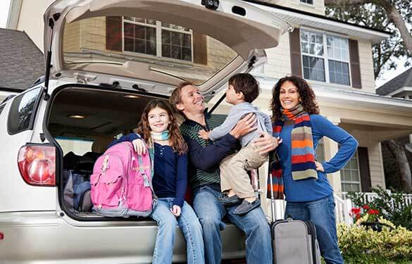 family packing the car for a fall road trip