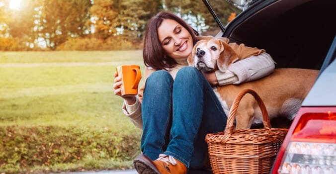 woman and her dog on a fall picnic