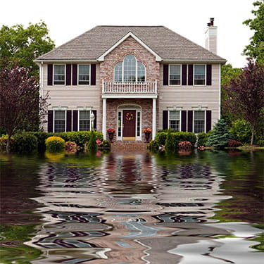 House with a flooded front yard
