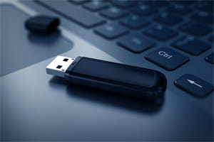 USB Flash drive on laptop keyboard