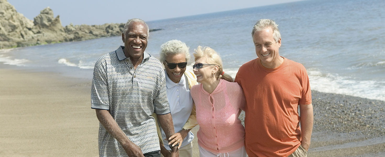 Two Older Couples Walking on Beach