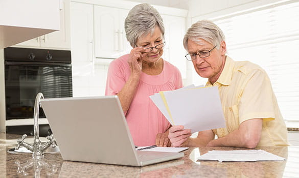 Older Couple Reading Medical Paperwork