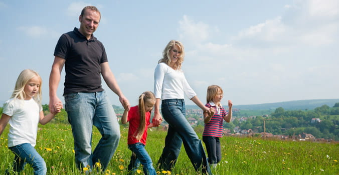 Mom, Dad and Kids Walking in Field