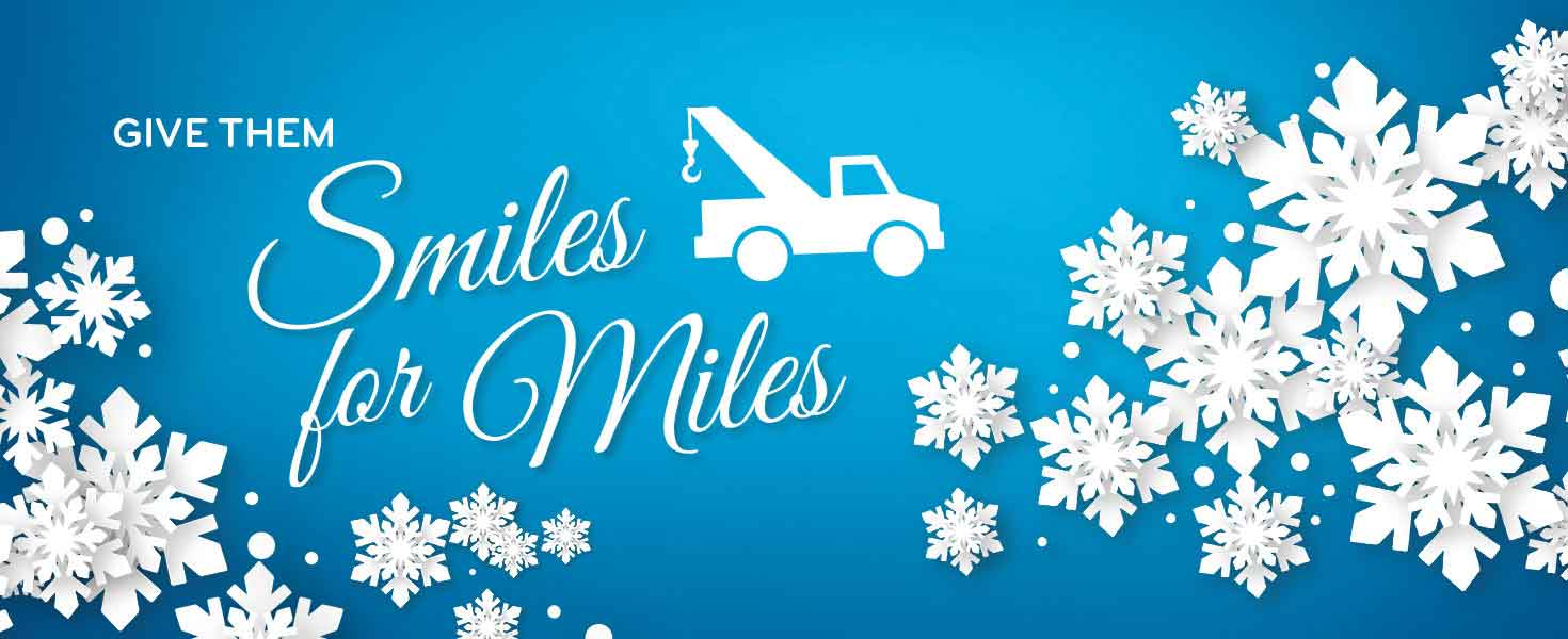 give them smiles for miles text with towtruck and snowflakes