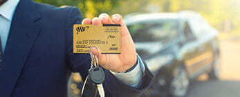 member holding card and keys