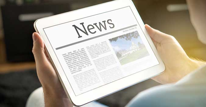 news story on a tablet