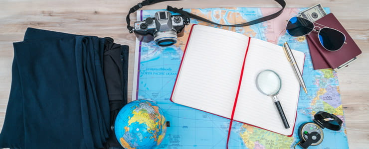 passport and other travel related items on a desk