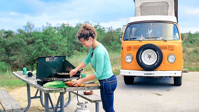 woman next to orange van