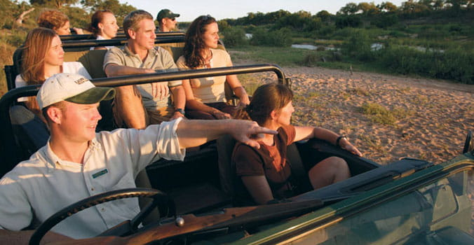 Group of travelers on africa safari tour.