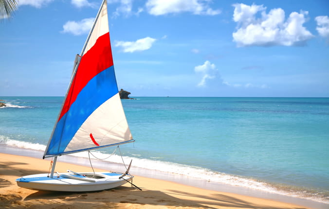 A sailboat on the beach in Antigua