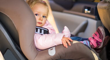 Little girl sitting in a car seat