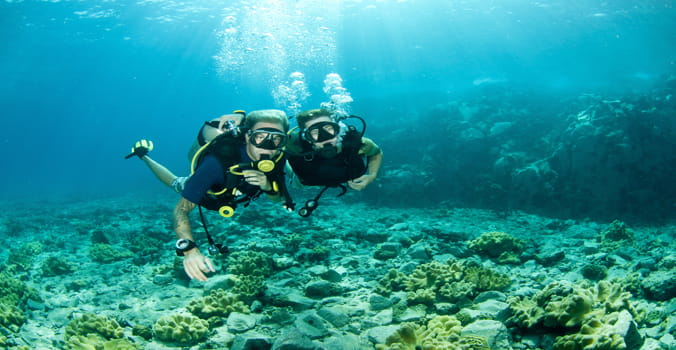 Man and Woman scubadiving in the Caribbean