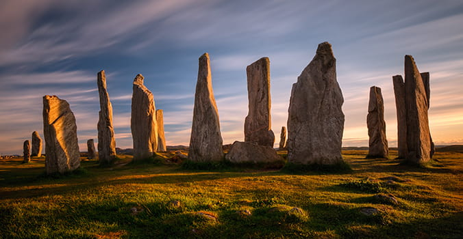 Callanish stones in sunset light, Lewis, Scotland stonecallanishscotlandagecalanaisironstandinglewisancientantiquearcheologybritainbritishcallinishcelticceremonialcircleculturehebrideshengehistorylandscapemegalithicmonumentnatureneolithicoldoutdoorouterreligionsilhouetteskysunsetShow more