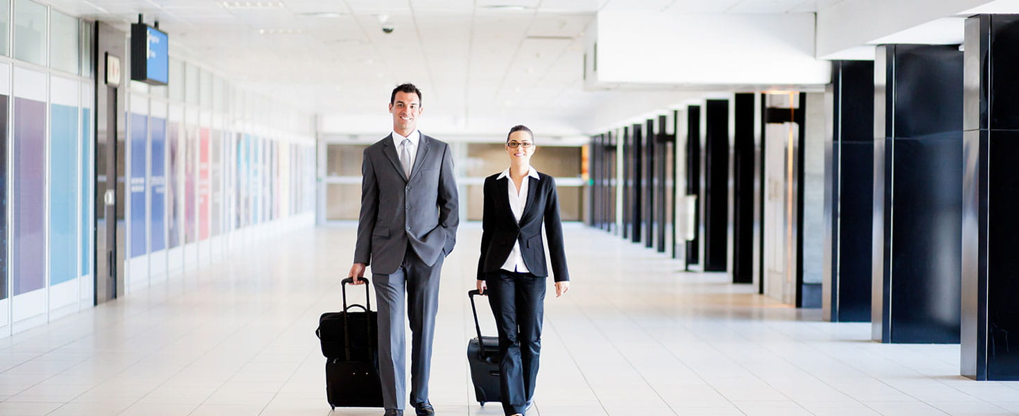 Corporate Travellers Walking Through Airport