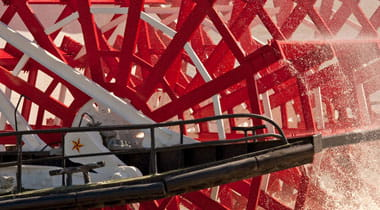 Movement of water by riverboat paddle wheel
