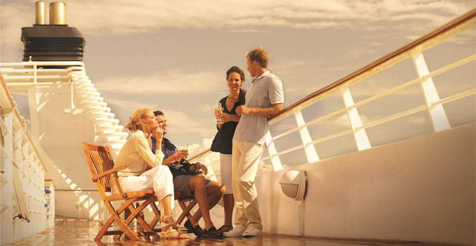 Friends talking on a cruise ship deck