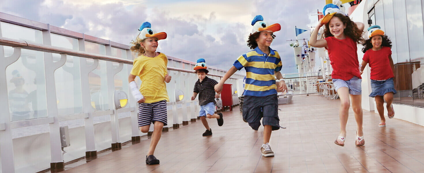 Kids playing and running along the deck of a disney cruise ship