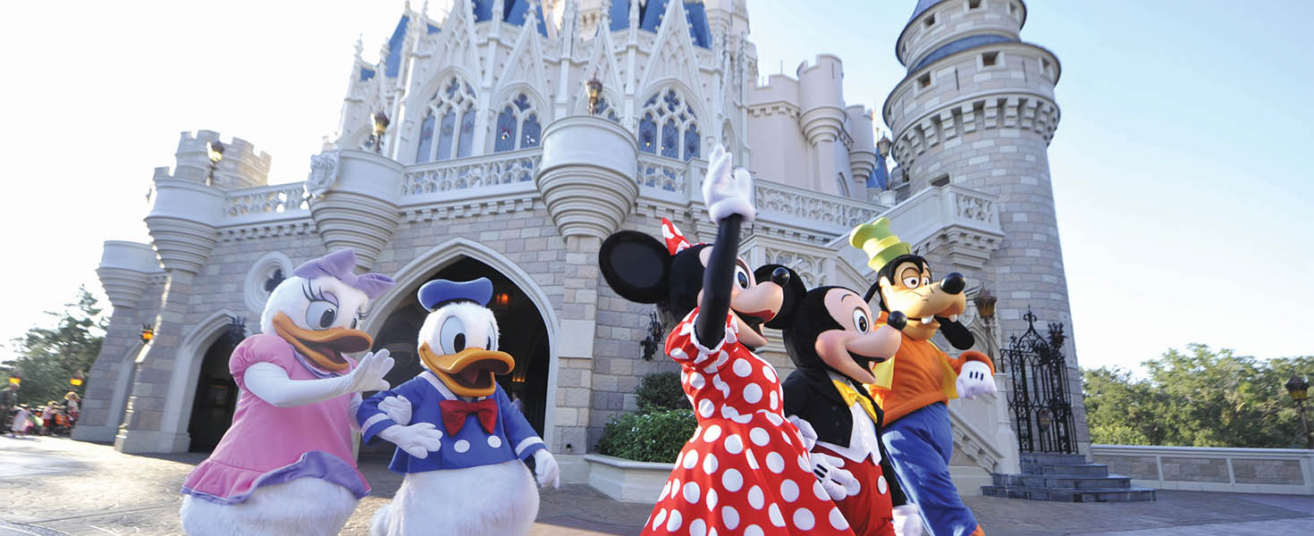 Mickey and friends laughing and walking in park