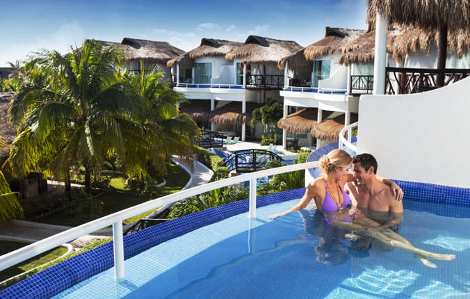 Couple in pool on the balcony of their suite at Eldorado Casitas
