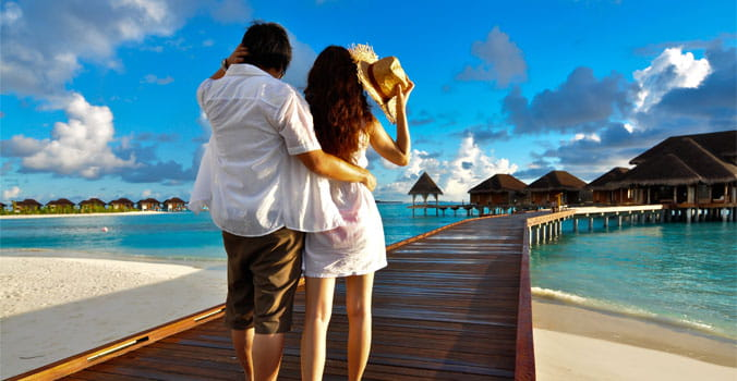 Couple on a pathway of luxury resort