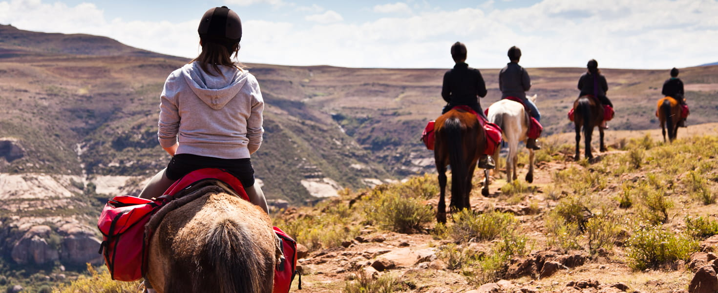 Family horse back riding in the mountains of Africa